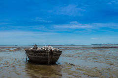 An old rowing boat in need of repair on the beach.  Royalty Free Stock Images