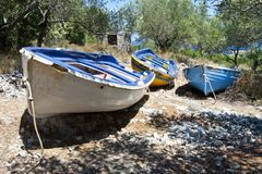 Old rowing boats putted up onto dry land Royalty Free Stock Image