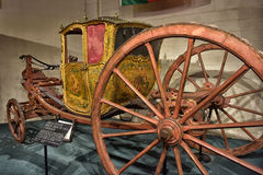 Old royal carriage. 18th century Berlin Coupe de Gala Carriage belonging to the Royal House of Portugal's King Joao V for princesses ceremony. now housed at car Stock Photography