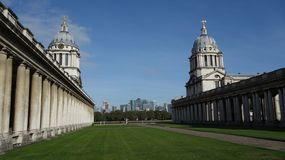 Old Royal Naval College and Canary Wharf stock images