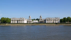 Old Royal Naval College in the Thames at Greenwich, England. Domes and buildings of the old Royal Naval College on the Thames in Greenwich, London Royalty Free Stock Images