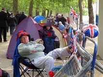 Old Royal Wedding fan. A senior fan of the royal wedding between Prince William and Kate Middleton waiting for the big event. Photo taken on April 28, 2011 near Royalty Free Stock Image