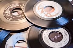 Old 45 rpm single records, backgrounds with modern touch. Mobile phone and camera. We shoot 45 rpm oldies single with modern touch in macro photography. With royalty free stock images