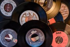 Old 45 rpm single records, backgrounds with modern touch. Mobile phone and camera. We shoot 45 rpm oldies single with modern touch in macro photography. With royalty free stock photography