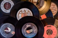Old 45 rpm single records, backgrounds with modern touch. Mobile phone and camera. We shoot 45 rpm oldies single with modern touch in macro photography. With stock image