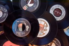Old 45 rpm single records, backgrounds with modern touch. Mobile phone and camera. We shoot 45 rpm oldies single with modern touch in macro photography. With royalty free stock image