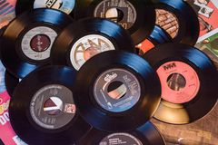 Old 45 rpm single records, backgrounds with modern touch. Mobile phone and camera. We shoot 45 rpm oldies single with modern touch in macro photography. With stock images