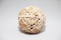 Old rubber band ball. Old cracked rubber band ball on isolated background Stock Photo