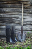 Old rubber boots and shovel Royalty Free Stock Images