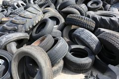 Old Rubber Tires in Recycling Dump Landfill Area. A group of old lazy tires waiting to be recycled for playgrounds, horse tracks and roads. A great picture for royalty free stock image