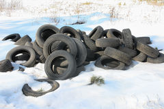 Old rubber tires on snow Royalty Free Stock Images