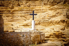Metal cross in the place of a hermit's shelter Royalty Free Stock Photo