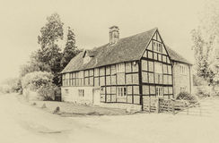 Old Tuder style house with vintage effect Royalty Free Stock Photography