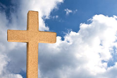 The old Rugged Cross. A rugged cross against a sky with clouds Royalty Free Stock Image