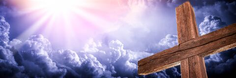 The Old Rugged Cross With Clouds And Glorious Light From Heaven