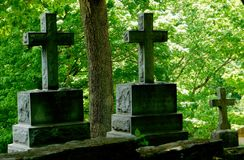 Old Rugged Crosses. Simple headstones weathered with age Royalty Free Stock Images