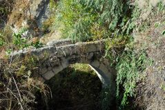 Ancient bridge, Turkey. Old ruin. Abandoned roman ancient stone bridge in mountain. Anatolia, Turkey Royalty Free Stock Photo