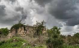 An old ruin on a cloudy day. This an old ruin that stands for decades and even more. The clouds ad some atmosphere Stock Photos