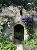 Old ruin turned into a secret garden with arched doorway
