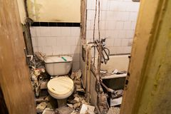 Old ruined apartment toilet interior royalty free stock images