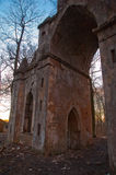 The old ruined arch in the Gothic style in Russia in the ruined manor Stock Image