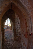 The old ruined arch in the Gothic style in Russia in the ruined manor Stock Images