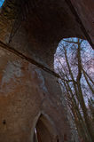 The old ruined arch in the Gothic style in Russia in the ruined manor Royalty Free Stock Photography