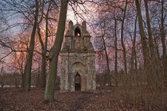 The old ruined arch in the Gothic style in Russia in the ruined manor Royalty Free Stock Images