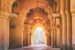 Old ruined arch of Lotus Mahal in Hampi, India. Old ruined arch of Lotus Mahal at sunset, Hampi, Karnataka, India royalty free stock image