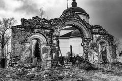 Old ruined arch. Russia, the destroyed arch in the cemetery Stock Images