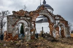 Old ruined arch. Russia, the destroyed arch in the cemetery Royalty Free Stock Photos