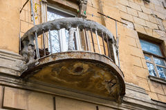 Old ruined balcony with rope and clothespins. Rostov-on-Don, Russia Royalty Free Stock Photo