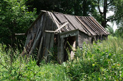 Old ruined barn in the countryside Russian federation Stock Image