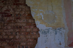 The old and ruined brick wall with plaster, lost places Stock Image