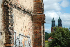 Old ruined building brick wall and church towers Royalty Free Stock Photos