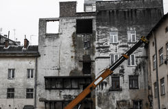 Old ruined building with crane . Duilding demolition Stock Image