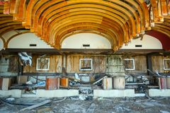 Old ruined building. KUPARI, CROATIA - JULY 19, 2017 : Devastated coffee shop of an old ruined hotel Goricina in abandoned Yugoslavian military resort in Kupari stock images