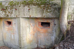 Old ruined bunker. Loopholes in the old devastated concrete bunker stock images