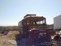 Old Ruined Bus. Old rusty bus Spooky and broken-down before the ghost town of jerome Royalty Free Stock Photography