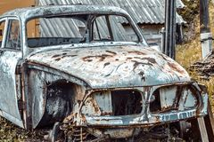Old ruined car. Old car, white car,1963 year royalty free stock image