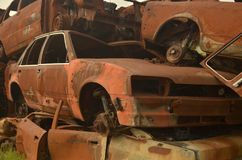 Old cars corroded on junkyard. The old ruined cars that were corroded thrown into junkyard stock photo