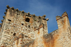 Old ruined castle. Exterior of old ruined castle with tower and battlements and blue sky background, Italy Stock Image