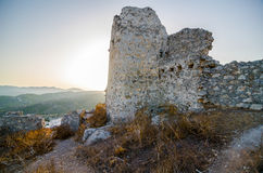 Old ruined castle at sunset Stock Images