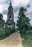 An old ruined Church on a forest road. stock photography