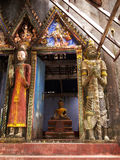 Old and ruined. Church and giant statue and buddha statue in front Stock Images