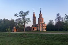 Old ruined Church of the 18th century in the village of Kolentsy, Russia. Early morning stock image