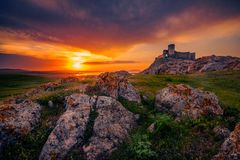 Old ruined citadel on a rocky hill shot at sunset with some rock. Old ruined citadel on a rocky hill located in Constanta County in Romania called Enisala shot Stock Photography