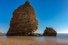 Old ruined defense tower near ocean, long exposure. Silk ocean water and old ruined defense tower near ocean stock photo