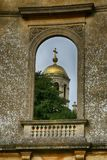 Old ruined domed window with gold domed church wrest park, west midlands Royalty Free Stock Photography
