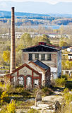 Old ruined factory. Abadoned old industrial buildings and the chimney royalty free stock photos